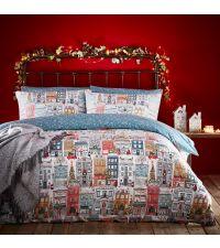 winterliche Bettwäsche mit Häusern, Christbäumen und Kränzen