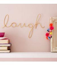 geschwungener, goldener Schriftzug 'laugh' aus zartem Draht