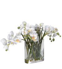 edles Kunstblumengesteck, weiße Orchideen in länglicher Glasvase