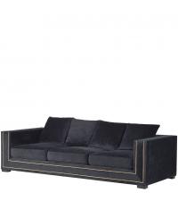 großes, schwarzes Samtsofa in geradliniger Form mit goldenen Details