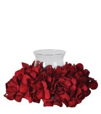 weihnachtliches Blumengesteck aus roten Hortensien mit Teelichtglas