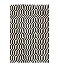 Wollteppich in schwarz-weiß mit welligem Zickzack-Muster