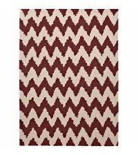länglicher Teppich aus handgetuftetem Acrylstoff mit Zickzack Muster in cremefarben und dunkelrot