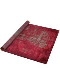großer, weicher Teppich mit abstrakter Musterung in Rotnuancen