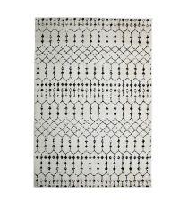 weicher, cremeweißer Teppich im Boho-Style mit schwarzem, geometrischen Muster-Druck