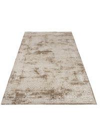 großer beiger Teppich im Boho-Style mit unregelmäßiger Musterung