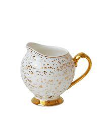 weiße Milchkanne mit Goldtupfen und goldenen Elementen