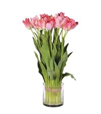 frühlingshafter Tulpenstrauß in kleiner Vase aus Glas, rosa