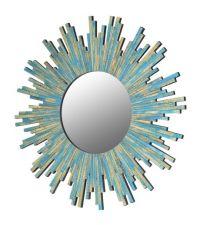runder Wandspiegel mit Strahlenrahmen und hellblauen Farbtupfern